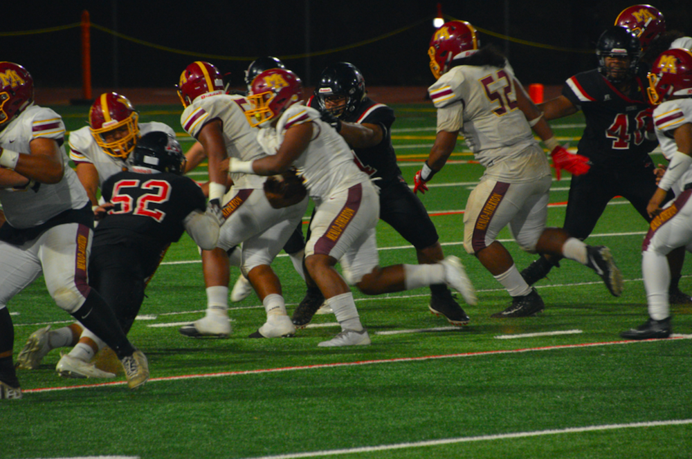 Menlo Atherton pounded out over 300 yards on the ground during their game against Aragon.