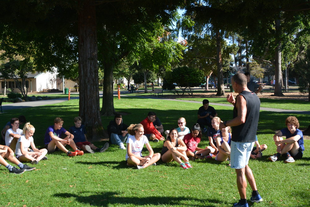Head coach Steve O'Brien delivers an impassioned speech to the cross country team.