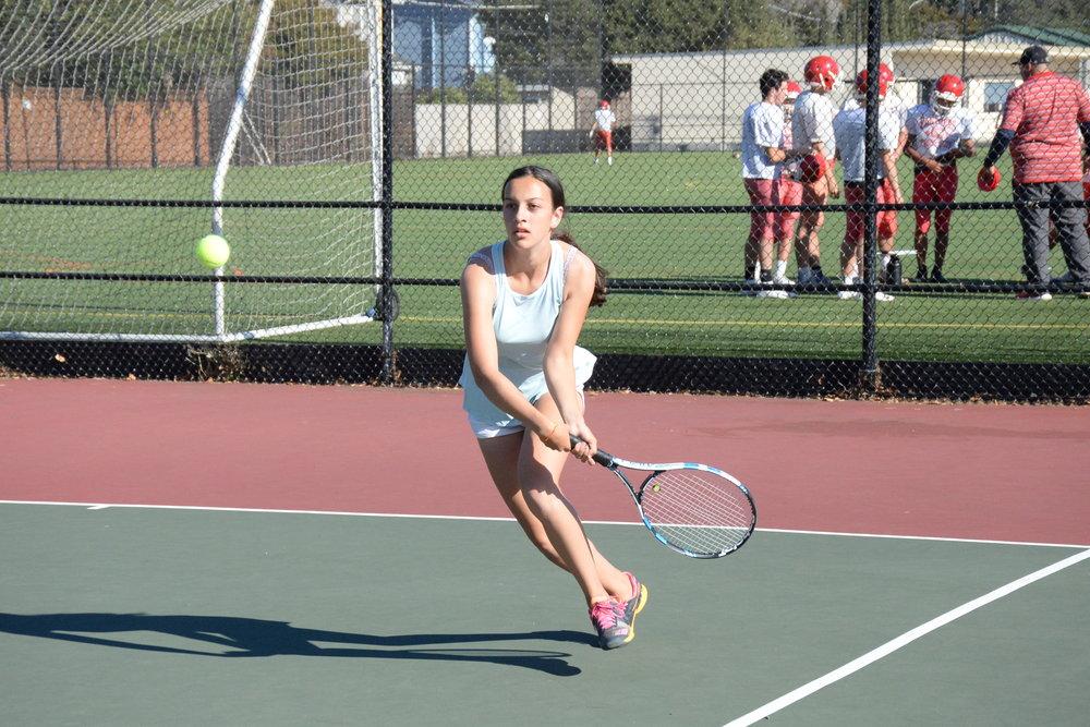 Freshman Annika Ganguly prepares to return a serve in Burlingame's game against Half Moon Bay.