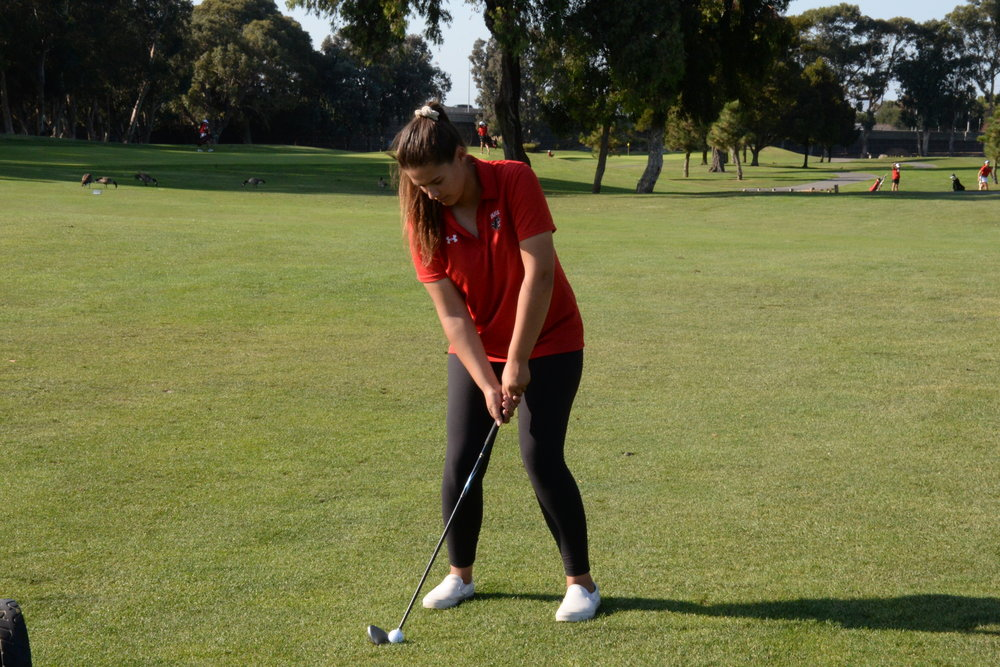 Burlingame Junior Sophia Palacio prepares to hit the golf ball in Burlingame's last game of the season.