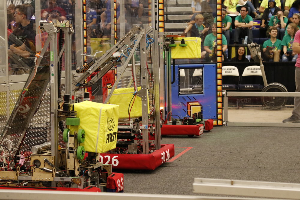 The Iron Panther's robot(center) and its team, enabled and waiting to start a match at Chezy Champs.