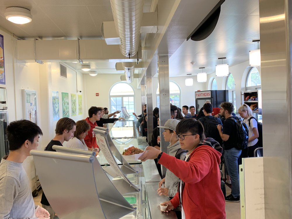 Students line up in the BHS cafeteria to receive their food.
