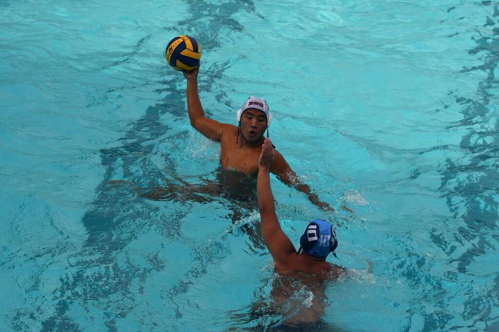 Senior Brandon Pham attempts to pass the ball in his game against Carlmont.