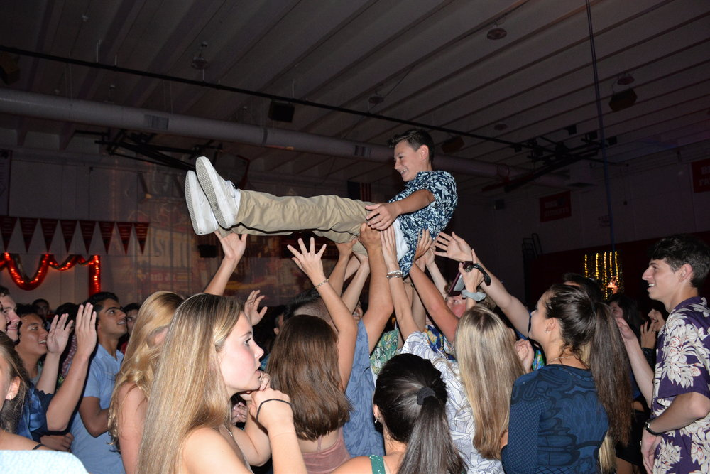 Students danced, moshed and wave-surfed during the eventful homecoming dance.