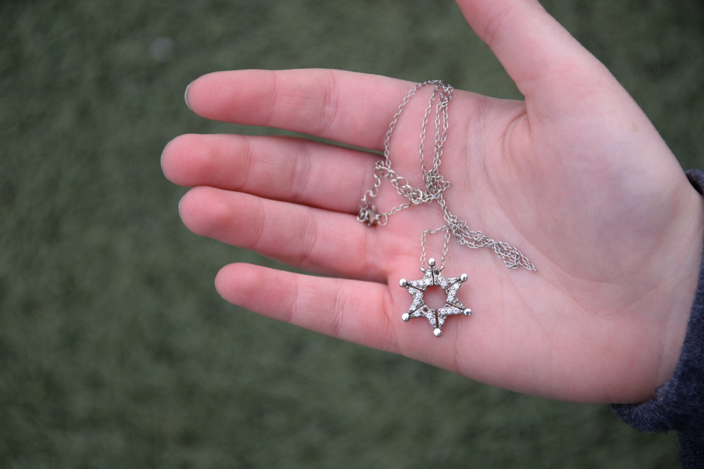 The Star of David is recognized as a symbol of Jewish identity. The  design of this necklace, belonging to freshman Zoe Steinberger, has a  story. During the Spanish Inquisition, Jews wore Star of David necklaces  which could unfold as butterflies in order to conceal their true  religious meaning. Steinberger's necklace is a modern replication of  this design.