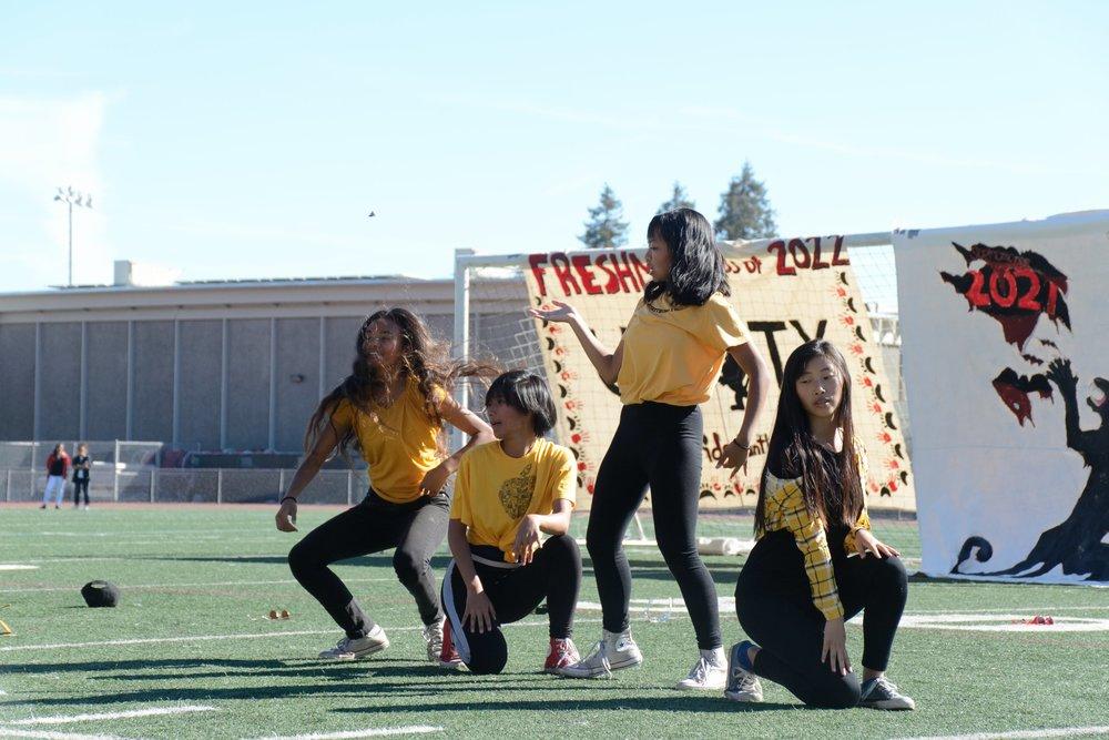 Freshmen show their spirit by wearing yellow during the Freshman dance routine.