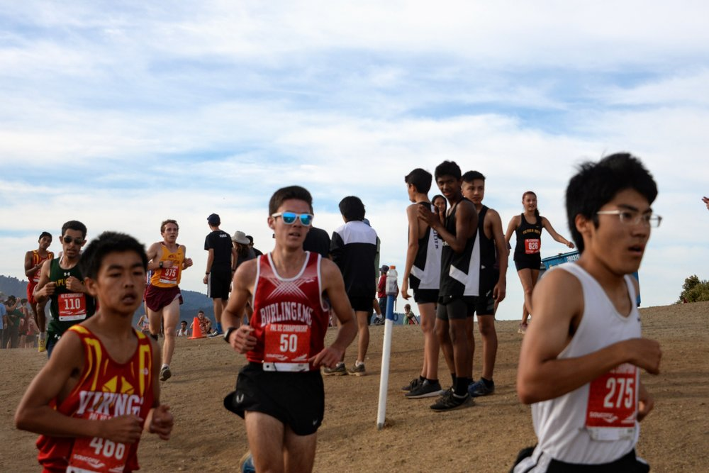 Brendan Creeks passes over a hill at the notoriously difficult Hallmark Park in route to his team low time of 17:18 during PAL Championships.