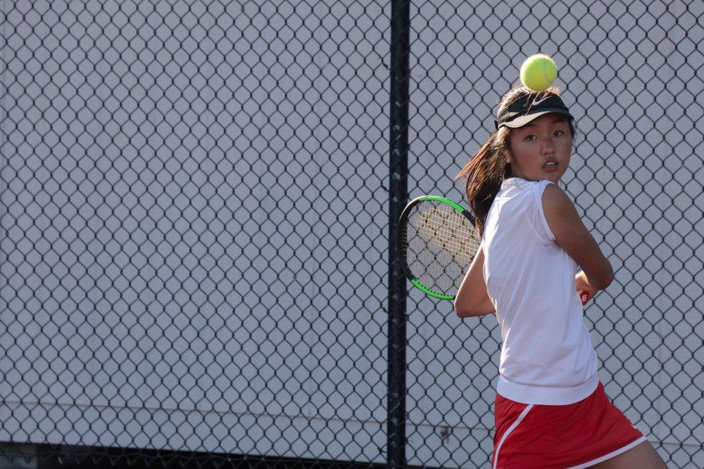 Sophomore Olina Du prepares to return a serve.