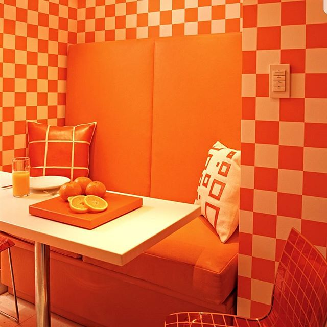 A Checkerboard Orange Kids Banquette!! Making Summer Dining FUN!! #orange#orangecrush#banquettes#ccinteriordesign#christophercolemaninteriordesign#color#coolkids#coolkidsrooms#decores#decoracion#colormebeautiful#decoratehappy#wallpaper