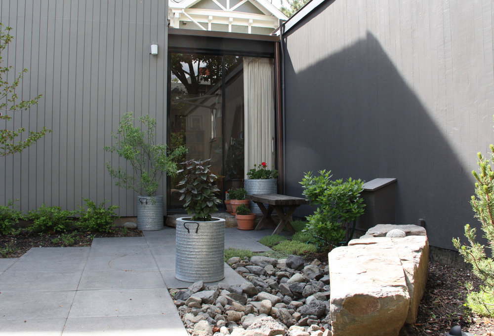 square paver patio with container plants