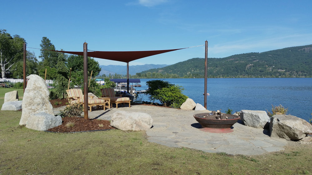 lakeside patio with shade sail