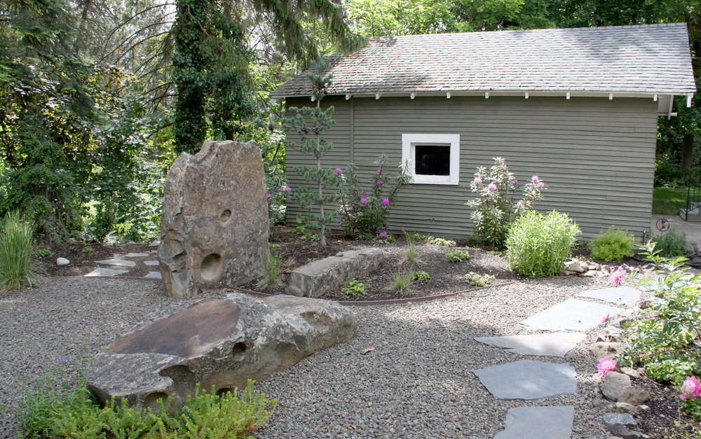 A flagstone path through crushed granite forms a comfortable walkway for bare feet and pets.
