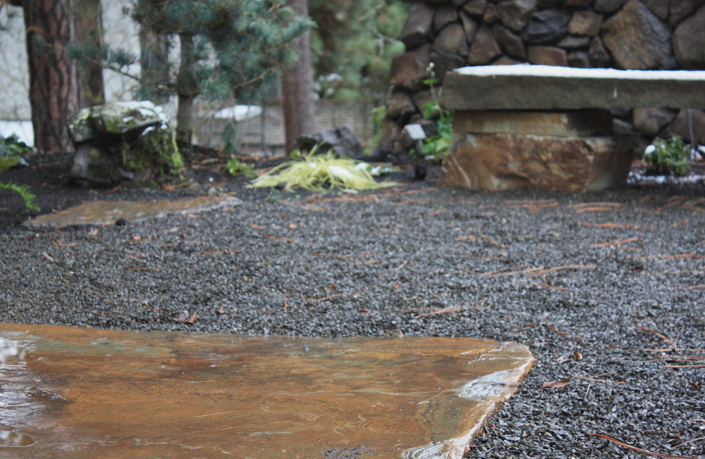 Small basalt chip creates a stable patio surface, but it can be uncomfortable on bare feet.