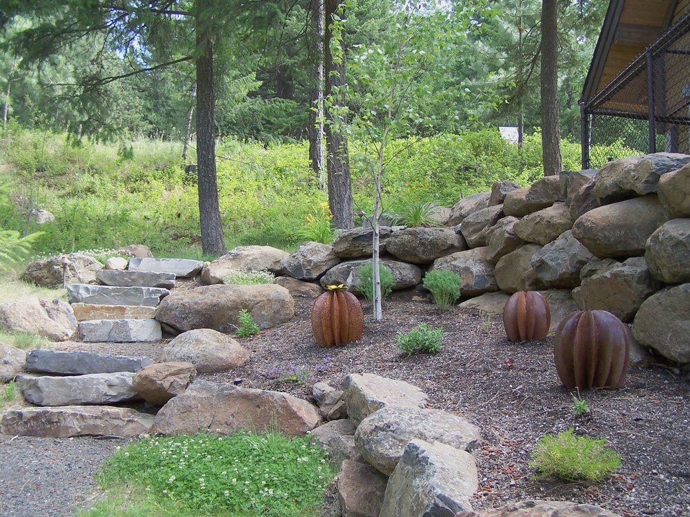 Steel barrel cactus sculptures bring a touch of the Southwest into this Spokane backyard.