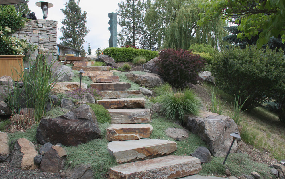 ... To Create A Lush Landscape. Creeping Thyme Spills Across The Quartzite  Steps, With Mounding Perennials And Bunch Grasses Tucked Into Planting  Pockets.
