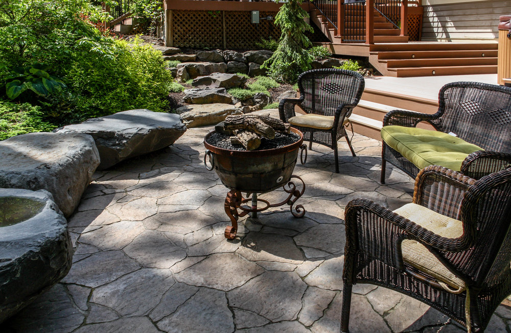 belgard mega arbel patio with fire pit and bench rocks