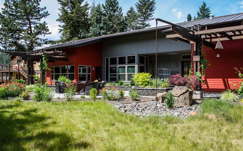 contemporary northwest landscaping with rain chains