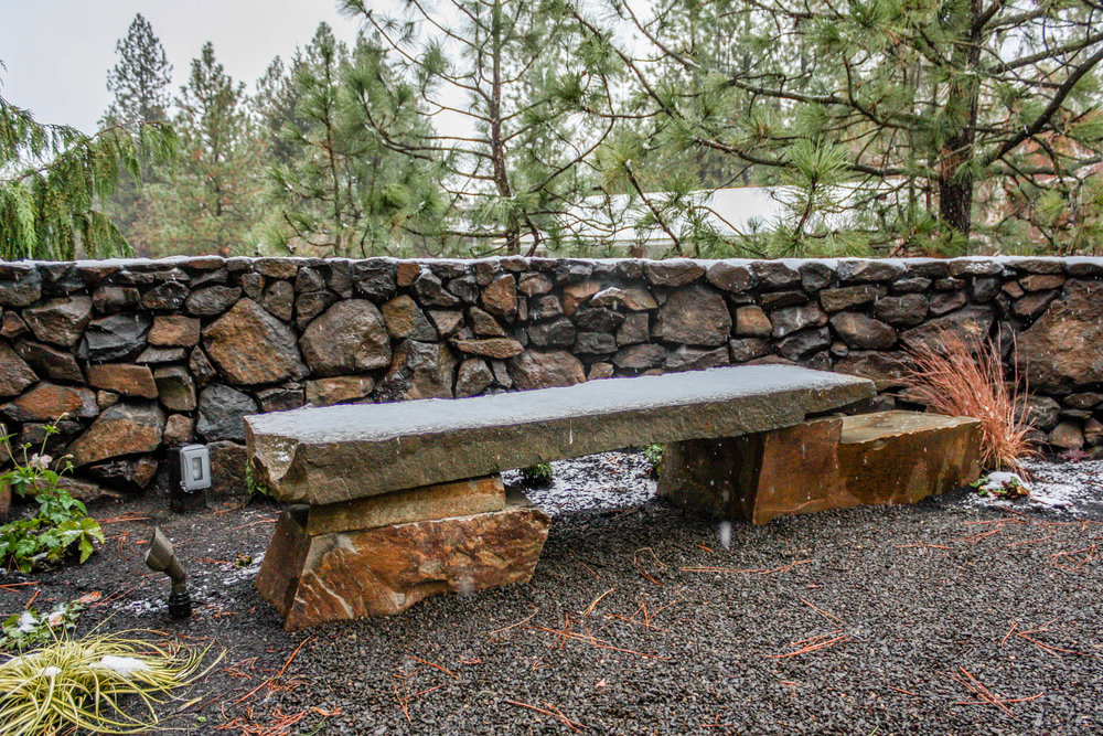spokane rockwork featuring stone bench and basalt wall