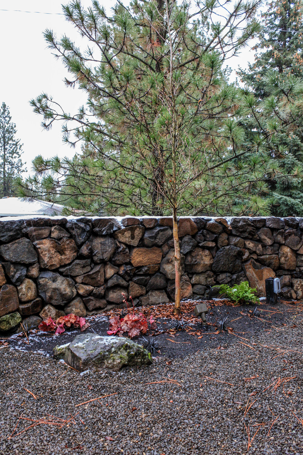courtyard landscaping with basalt wall in spokane