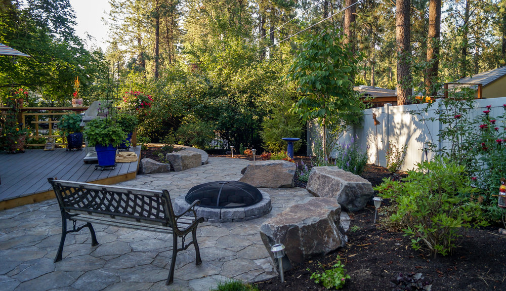 sunken fire pit and bench rocks on spokane south hill
