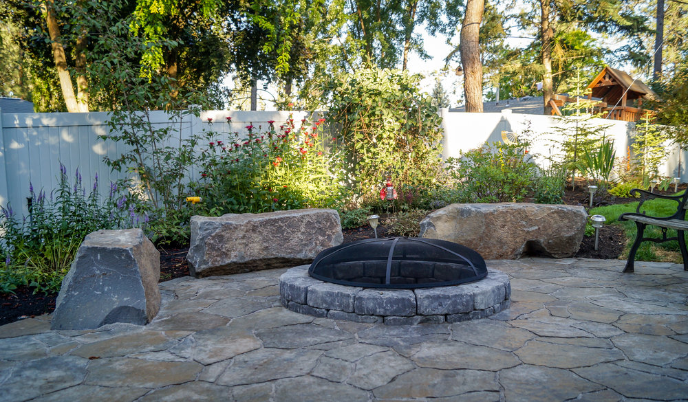 belgard mega arbel paver patio with basalt column bench rocks around fire pit on spokane south hill