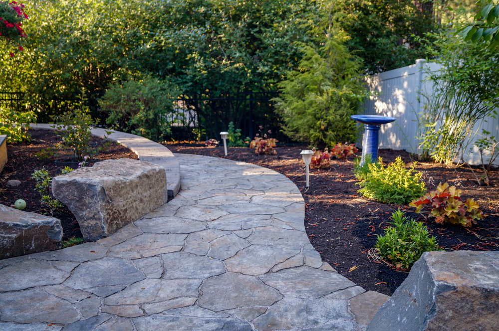 belgard mega arbel paver pathway around retaining wall and boulders with northwest landscaping