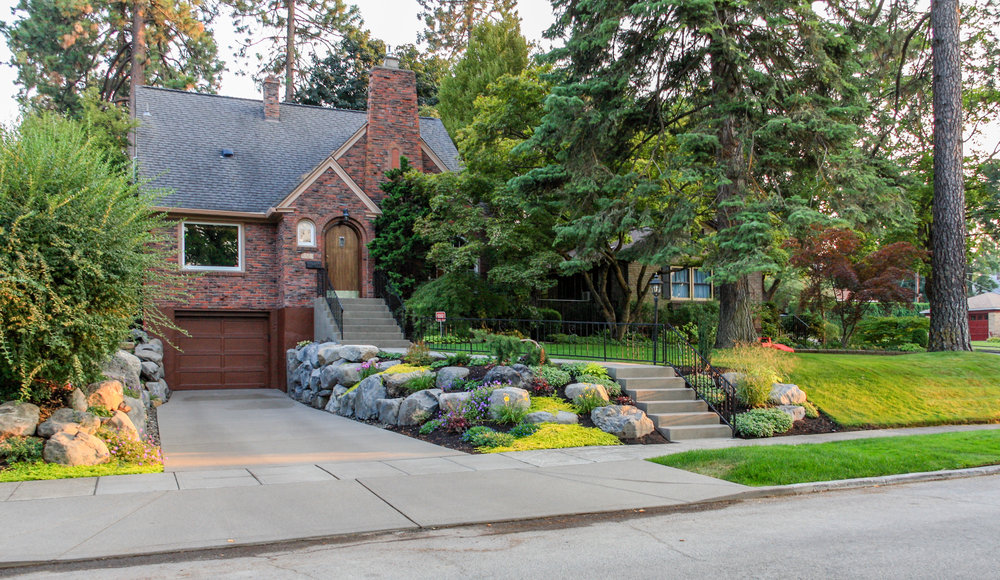 south hill tudor bungalow with new retaining walls and driveway