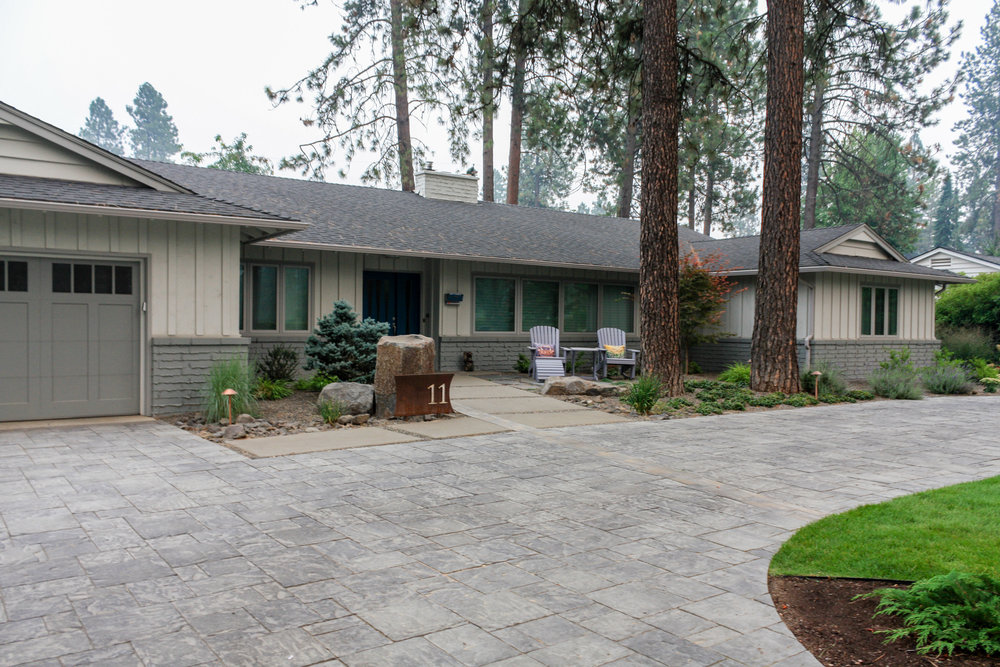 mid century ranch with paver driveway