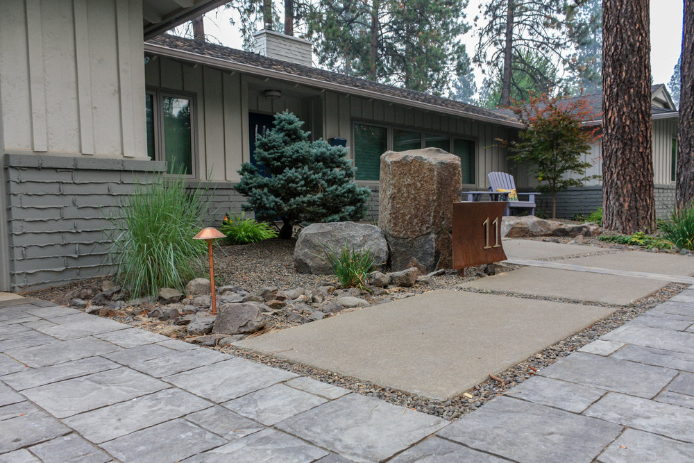 sandwashed concrete pad walkway with pavers