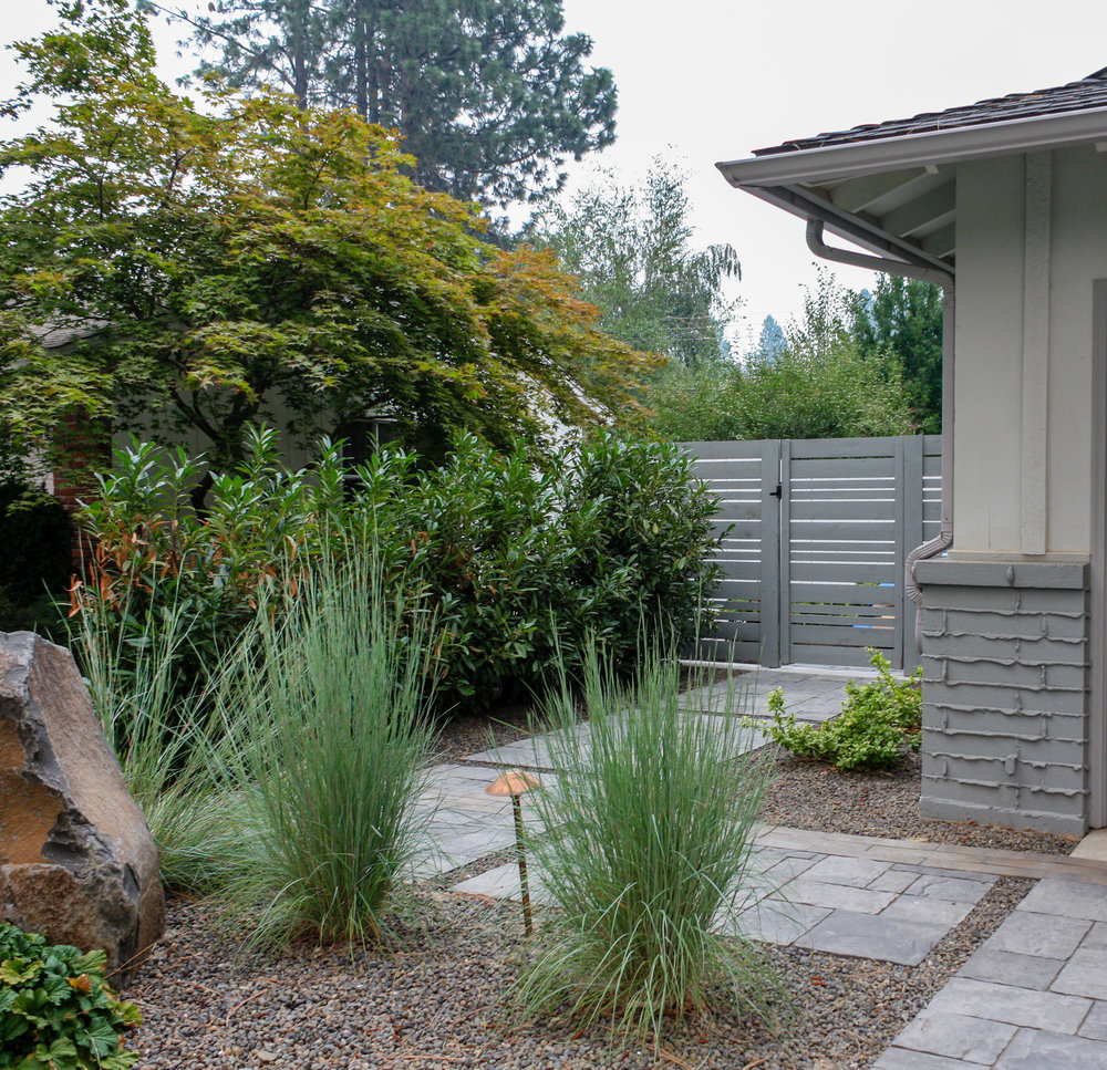 spokane landscape with paver walkway and horizontal wood fence