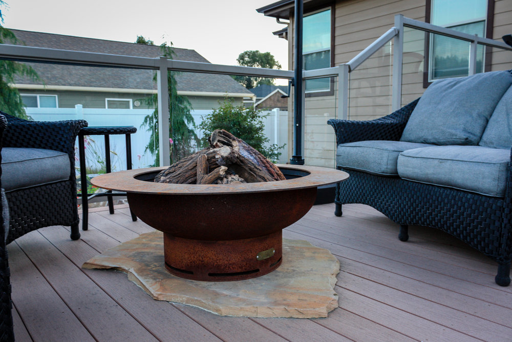 gas fire pit on deck with sandstone slab