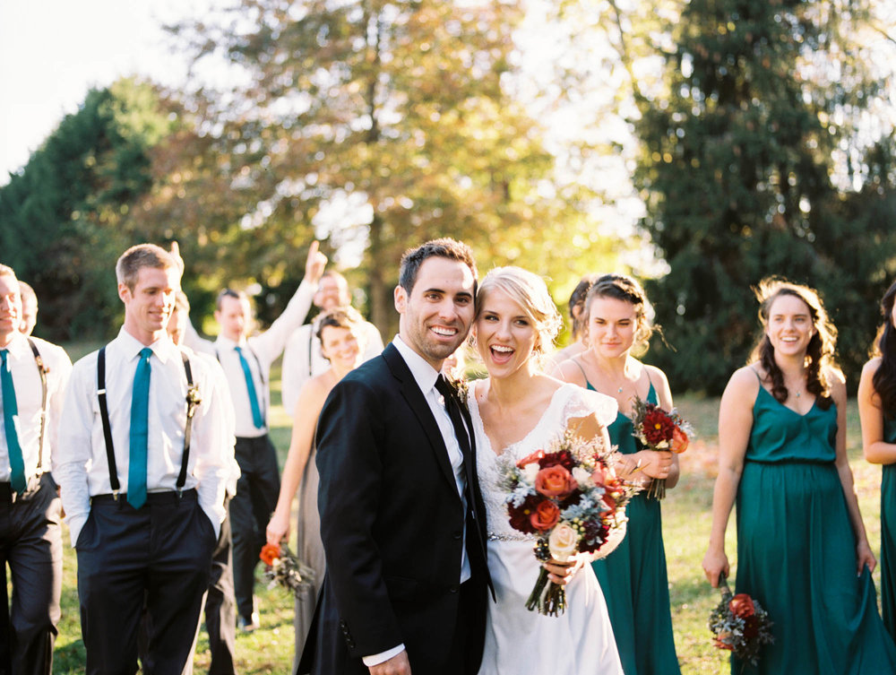 ONE OF MY FAVORITE PICTURES WAS OF ME AND BRYAN AND OUR GROOMSMEN AND BRIDESMAIDS. WE ARE ALL CLOSE TOGETHER AND EVERYONE IS LAUGHING AND HAVING A GOOD TIME AND THE PICTURE REALLY CAPTURED THAT MOMENT AND STILL MAKES ME SMILE TO THIS DAY!  — Deborah, bride