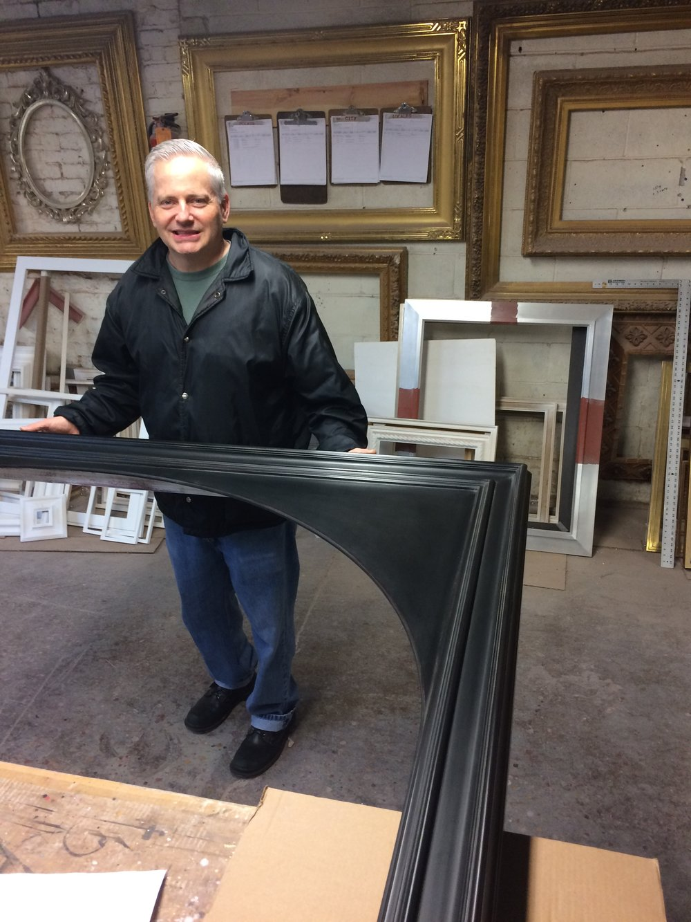 Heritage Frame & Picture Co. Owner, Ted Howell with the huge uninstalled frame