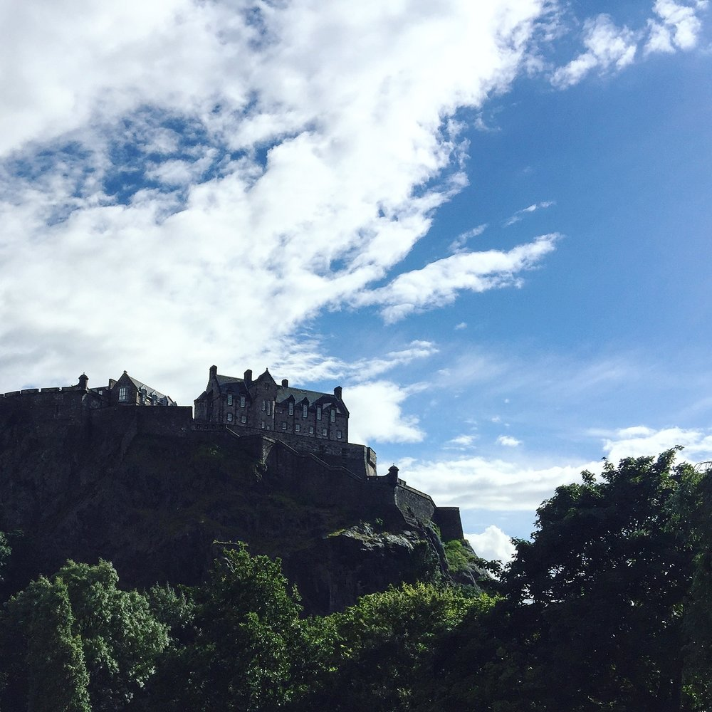 Edinburgh Castle perched dramatically over the city, overlooking Princes Street Gardens.