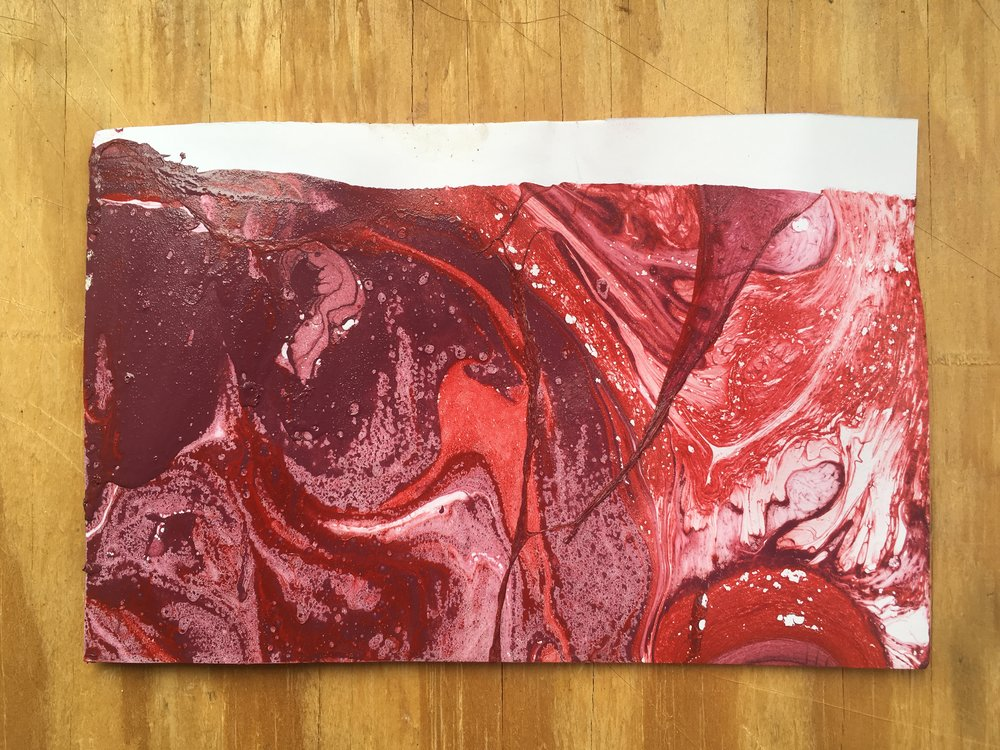 Cary is teaching a Printmaking class and they've been doing some experiments with spray paint on paper.