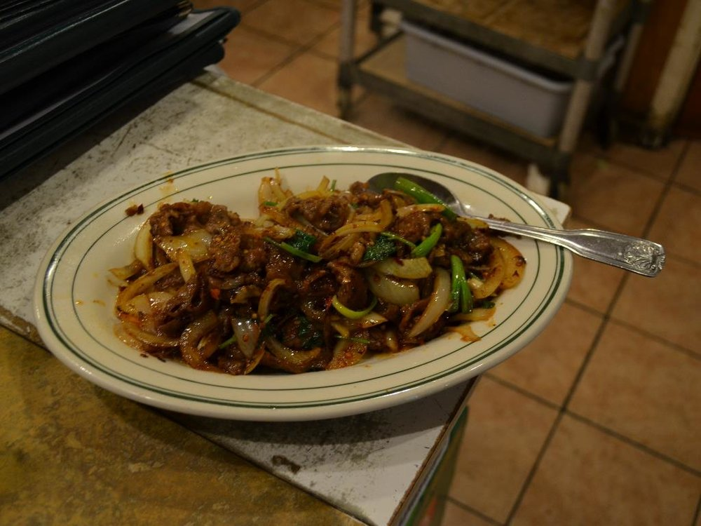 Sichuan Beef   四川牛 - Beef stir-fried with yellow and green onions, cilantro