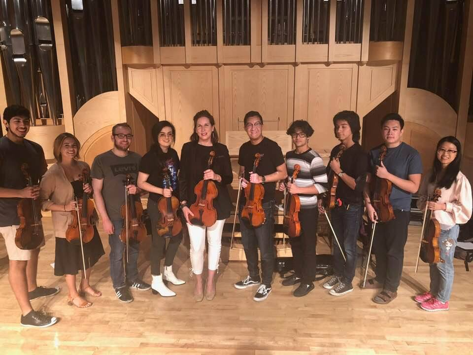 UNLV Studio - Kate Hamilton is pictured here on the stage of Doc Rando Hall at UNLV with some members of her viola studio.