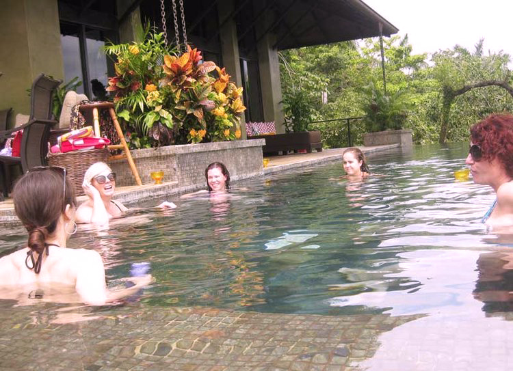 Ash Ambirge in pool at Costa Rican Business Retreat with Shireen Bawnlavery