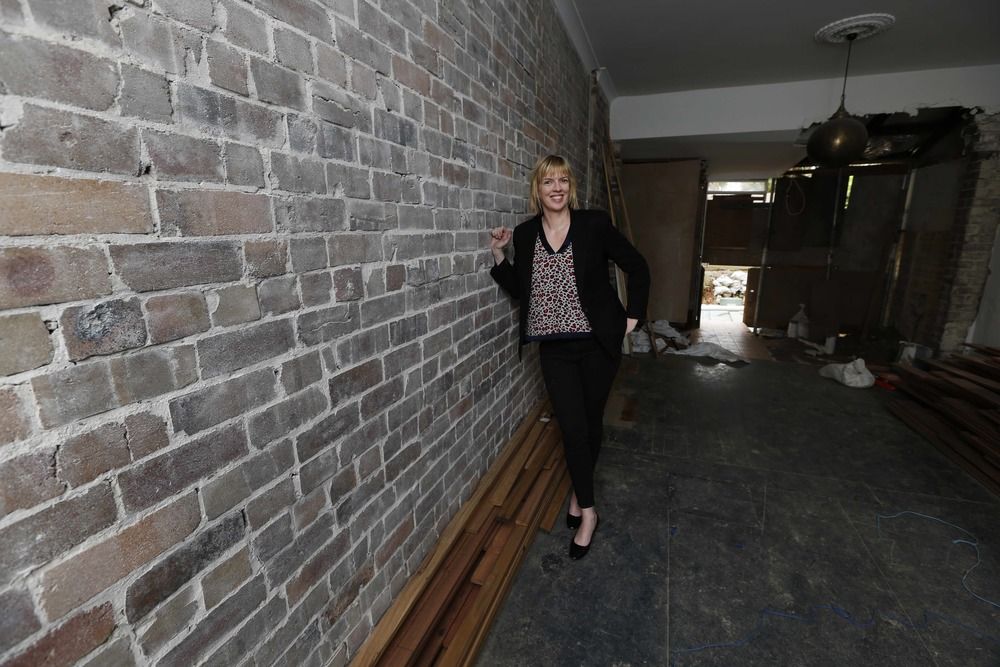 kylie next to brick wall in living room_LR.jpg