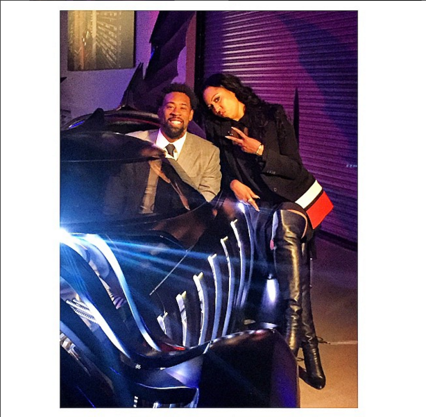 Paige Geran with client, DeAndre Jordan, behind the scenes with the Batmobile