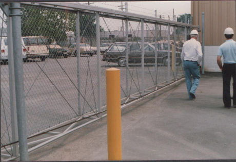 International Gate Devices Aluminum Square Slide Gate Track System.  Installed on a box frame gate.