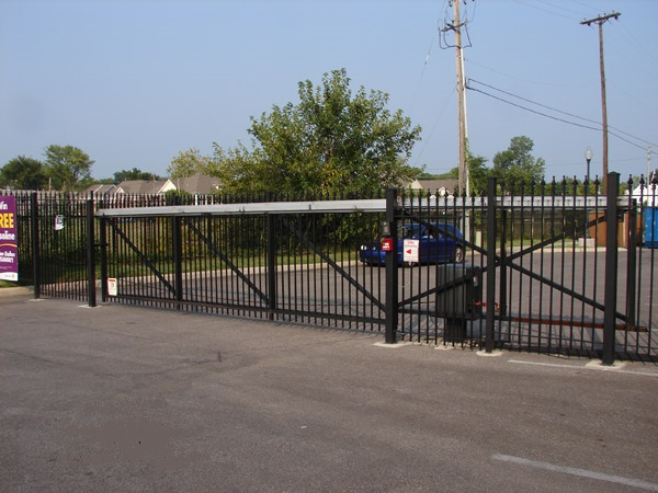 International Gate Devices Aluminum E/Z Slide Gate Track System.  Bolted on to a square frame.