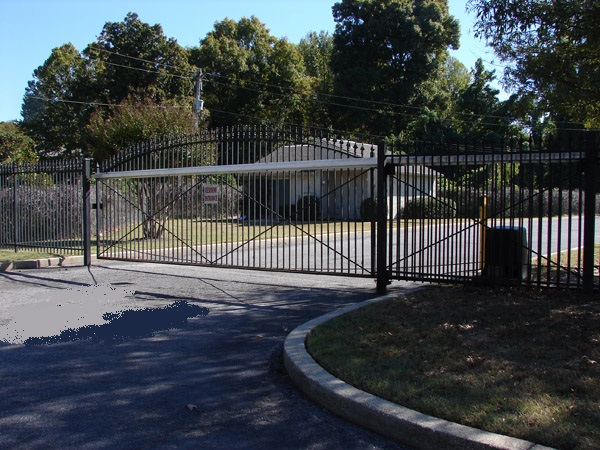 International Gate Devices E/Z Slide Aluminum Gate Track Kit.  Mounted to an Arched Top Estate Gate.