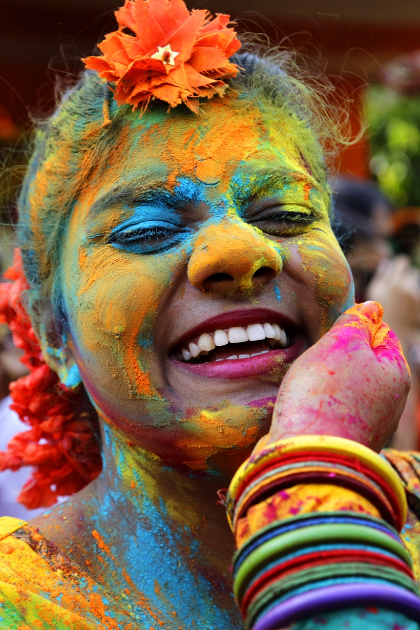 Happily doused in pigmented powder, this woman has colour covered, celebrating Holi 2016 in Kolkata, India