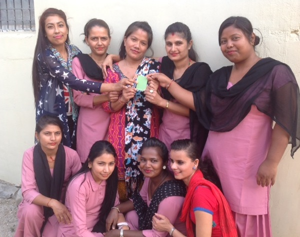 Posing with their pick for 'colour of the year,' the women of Samunnat are ready for the best year yet!