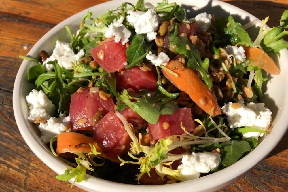 Winter Salad  Roasted beets, arugula, frisée, goat cheese, shaved carrots, pumpkin seeds, granola.