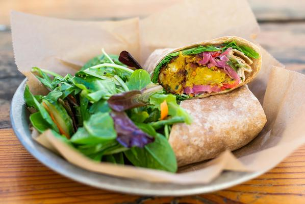 Falafel Wrap  Curried chickpeas, cucumbers, arugula, ginger yogurt, pickled red onion, and an organic whole wheat tortilla. Served with a salad of mixed greens with an apple vinaigrette.