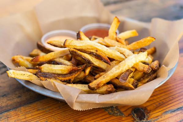 Basket of Fries  House cut french fried potatoes with house ketchup and sriracha mayo.
