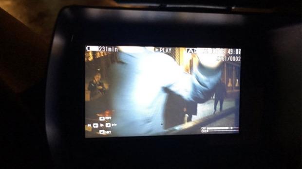 Cardinal Pell's security shoving an Australian TV camera.  Photo: Hugh Whitfeld,via Twitter