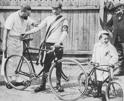 Maurice Garin; Inaugural winner of le Tour. And some random kid.